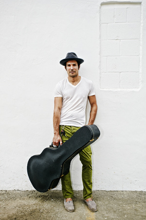 Mixed Race Musician Carrying Guitar Case LANG_EVOIMAGES
