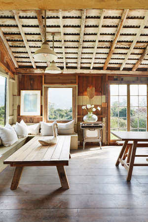 Coffee Table, Sofa And Ceiling Beams In Rustic Living Room
