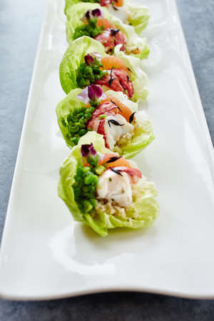 Close Up Of Fresh Seafood Salad In Lettuce Cups