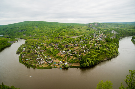 Aerial View Of Village Near Bend In River