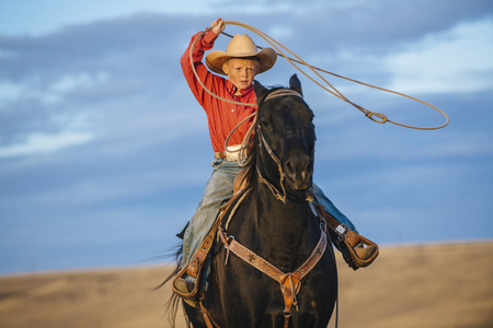 Caucasian Boy On Horse Throwing Lasso