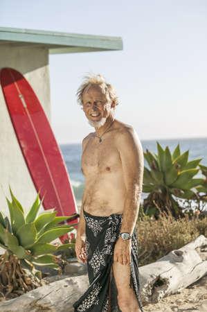 Older Man Smiling On Beach LANG_EVOIMAGES