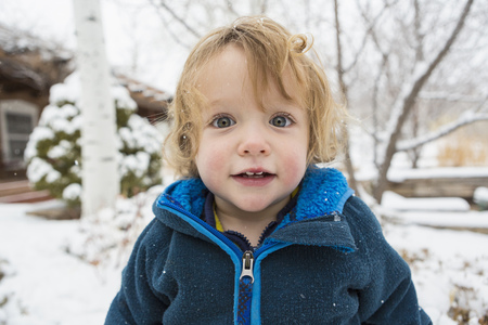 Caucasian Boy Standing In Snow LANG_EVOIMAGES