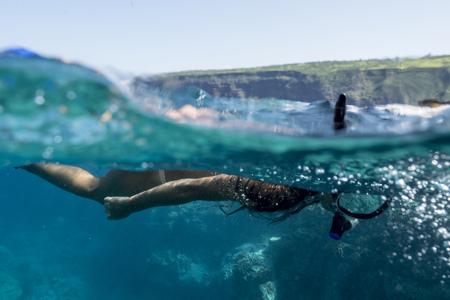 Mixed Race Woman Snorkeling In Tropical Ocean