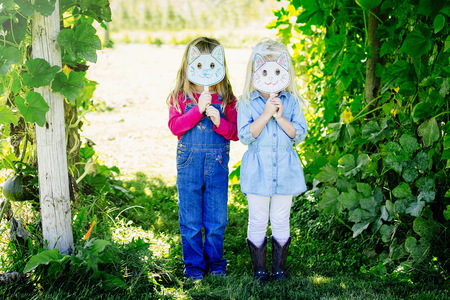 Caucasian Girls Holding Cat Mask