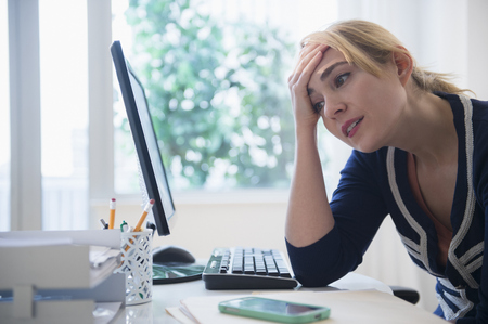 Frustrated Caucasian Businesswoman Using Computer LANG_EVOIMAGES