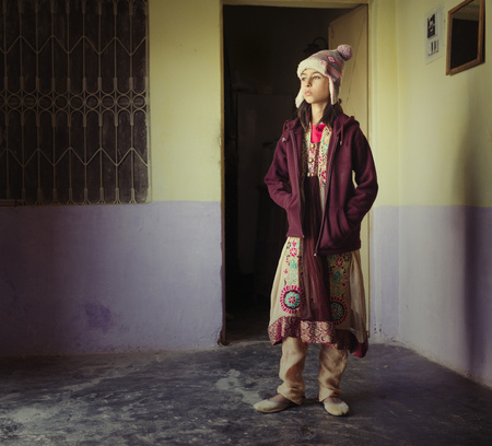 Mixed Race Girl Wearing Traditional Clothing