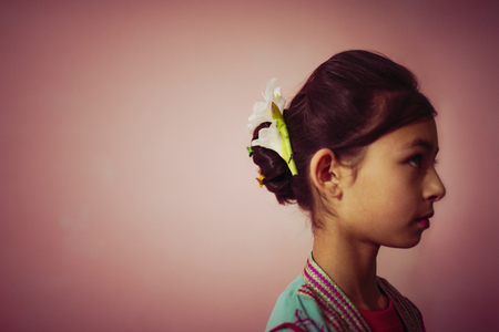 Mixed Race Girl Wearing Flowers In Her Hair LANG_EVOIMAGES