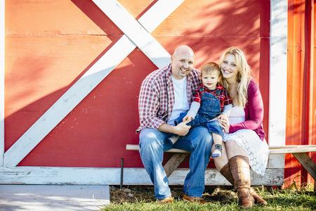Caucasian Family Smiling Outside Barn