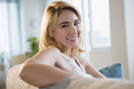 Caucasian Woman Smiling On Sofa