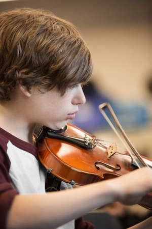Caucasian Student Musician Playing Violin