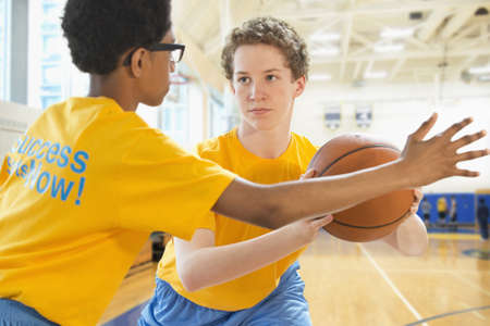 Basketball Players Practicing In Gym