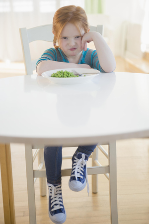 Caucasian Girl Pouting At Plate Of Vegetables LANG_EVOIMAGES