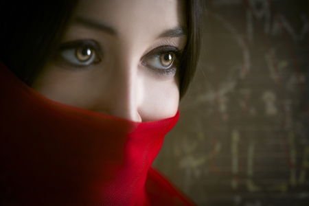 Close Up Of Woman Wearing Red Face Scarf