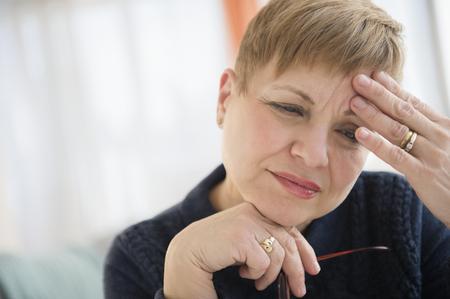 Anxious Caucasian Woman Rubbing Forehead