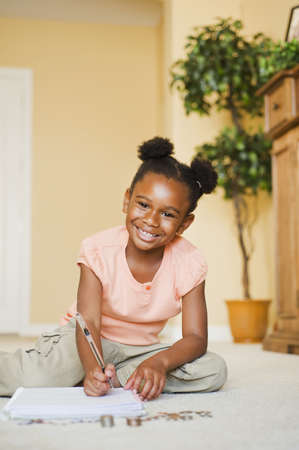 African American Girl Counting Coins On Floor