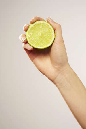 Caucasian Woman Holding Sliced Lime
