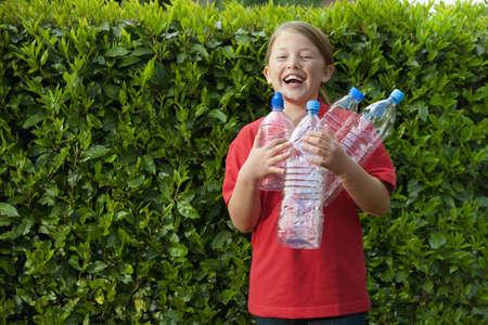 Caucasian Teenage Girl Carrying Empty Bottles
