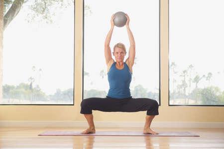 Caucasian woman doing aerobic exercises near window LANG_EVOIMAGES
