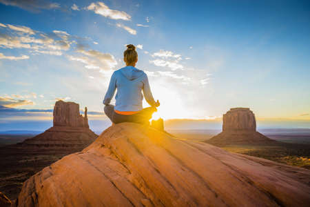 Caucasian woman meditating in Monument Valley, Utah, United States