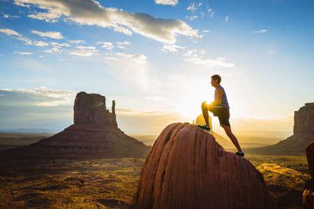 Caucasian man stretching in Monument Valley, Utah, United States