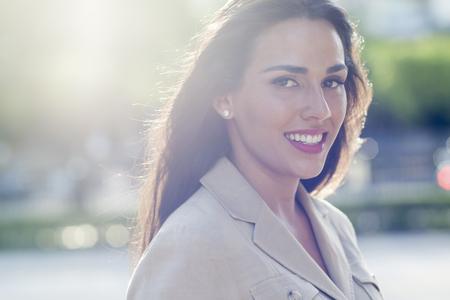 Hispanic businesswoman smiling outdoors LANG_EVOIMAGES