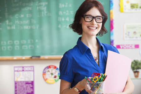 Caucasian teacher smiling in classroom