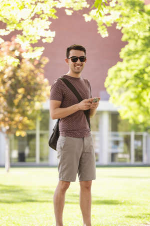Student using cell phone on college campus