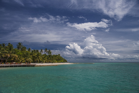 Clouds over tropical island LANG_EVOIMAGES