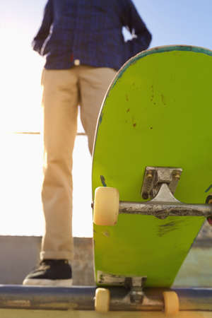 Low angle view of Caucasian man standing on skateboard