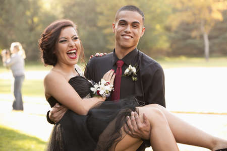 Teenage boy carrying prom date LANG_EVOIMAGES