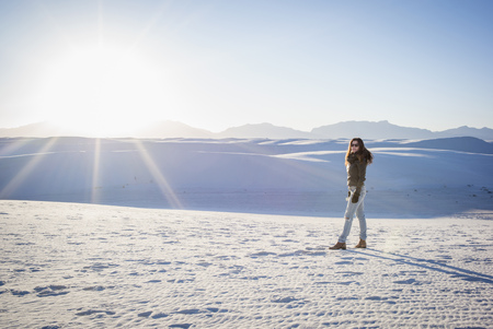 Caucasian woman standing in White Sands National Park, New Mexico, United States LANG_EVOIMAGES