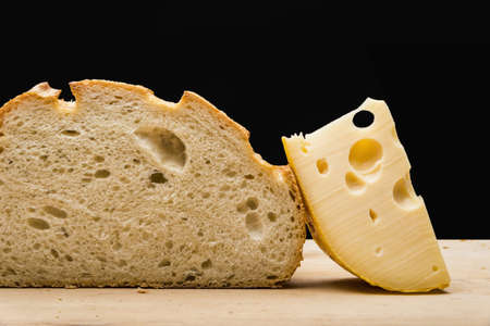 Close up of cheese slice and bread on cutting board LANG_EVOIMAGES