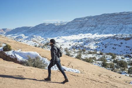Caucasian woman hiking on remote hillside