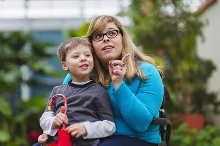Paraplegic mother and son exploring outdoors