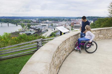Couple admiring view of Columbus cityscape, Ohio, United States