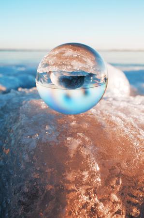 Crystal ball on glacier LANG_EVOIMAGES