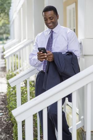 Black businessman using cell phone