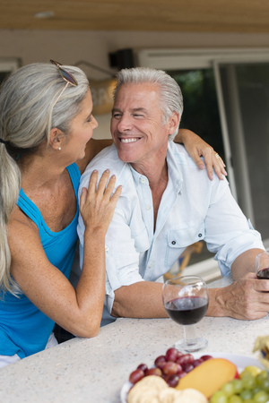 Caucasian couple drinking wine at table