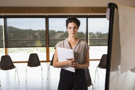 Mixed race businesswoman working in meeting room