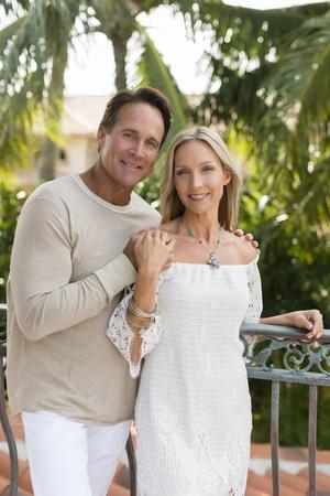 Caucasian couple hugging outdoors Banco de Imagens - 95490306