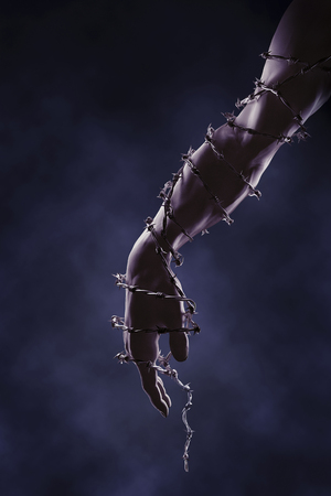 Arm and hand wrapped in barbed wire LANG_EVOIMAGES