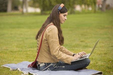 Caucasian college student using laptop on campus