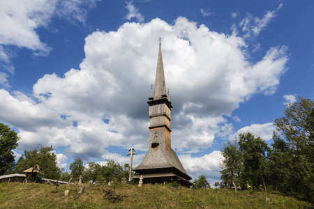 Church tower under cloudy sky