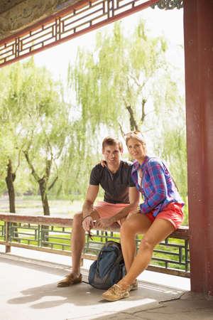 Caucasian couple smiling on patio