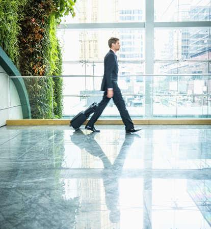 Caucasian businessman walking in office