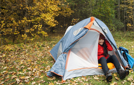 Hiker sitting in tent at campsite LANG_EVOIMAGES