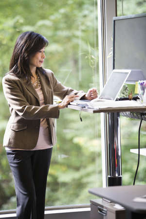 Chinese businesswoman using laptop in office