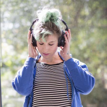 Caucasian woman listening to headphones