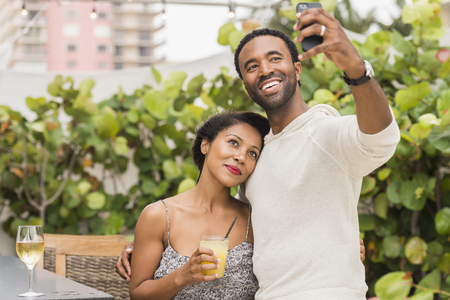 Couple taking selfie outdoors LANG_EVOIMAGES